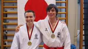 Andrey och Edvin med medaljerna